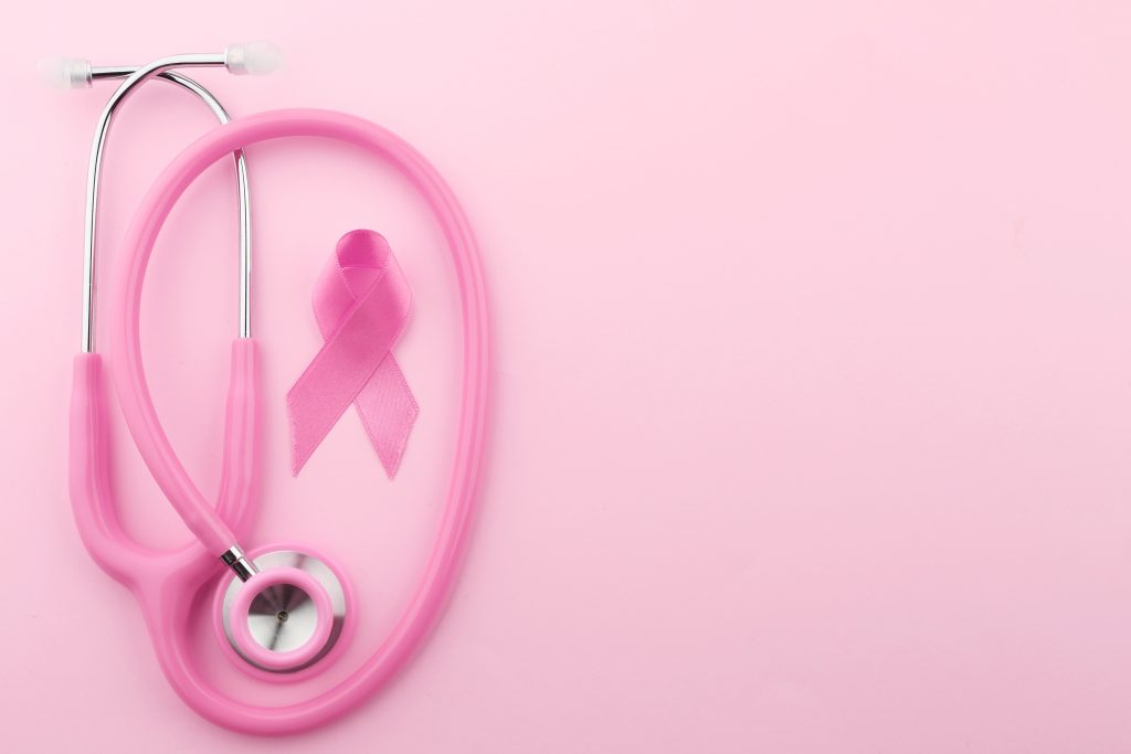 Stethoscope with pink ribbon on color background. Breast cancer concept